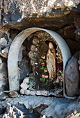 A Madonna in the wall of Girolamo Russo's vineyard, Passopisciaro, Sicily, Italy