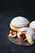 Traditional Polish donuts filled with marmalade and dusted with icing sugar