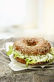 A bagel with lettuce and cream cheese