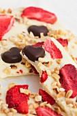 White chocolate with strawberries, dark chocolate and nuts