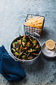Mussels in vegetables broth