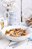 A bowl of homemade breakfast muesli with milk