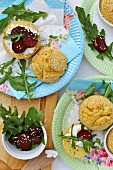 Gluten-free sesame seed rolls on colourful paper plates, served with beetroot and rocket