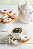 Doughnuts and coffee on a white table