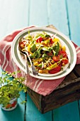 A colourful salad with peppers and chickpeas