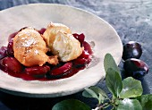 Mutzen (Karneval pastry from the Rhineland, Germany) in plum compote