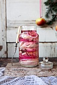 A jar of pickled herring with red onions