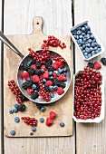 Various berries in cardboard planets and a frying pan
