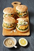 Fish burgers with coleslaw and a cold spinach sauce