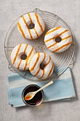 Doughnuts with white glaze and caramel sauce