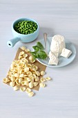 ingredients for pasta with ricotta and green peas and mint