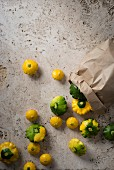 Pattypan squash next to a paperbag