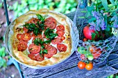 A tomato tart with fried basil leaves