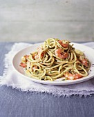 Spaghetti with almond pesto and prawns