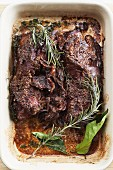 Slow cooked lamb with rosemary and bay leaves
