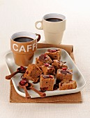 Chocolate brownies with dried cranberries served with coffee