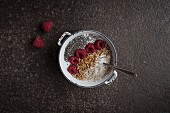 Muesli with yoghurt, raspberries, chia seeds and buffalo worms