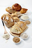 Various loaves of organic bread, brioche, croissant and different types of flour