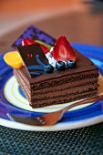 A layered chocolate cake with fresh berries