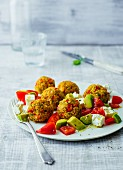 Millet falafal with a tomato and avocado salad