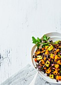 Vegan beluga lentil salad with dates, mango and avocado