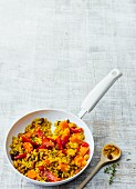 Sweet fried rice and carrot with raisins, honey and peanuts