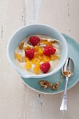 Orange and quark cream with raspberries and sea buckthorn juice (post fasting)