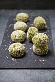 Spinach and chickpea dumplings with sesame seeds