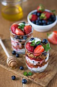 Yoghurt parfait with cereals, strawberries and blueberries