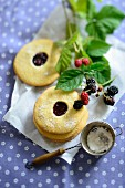Blackberry biscuits with jam and icing sugar