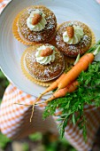 Carrot cupcakes with marzipan decorations