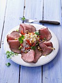 Roast beef carpaccio with a glass noodle and bean sprout salad