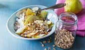 Apple and pear muesli with soya yoghurt and wheat flakes