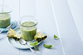 Pineapple and stinging nettle smoothie with coconut water and basil
