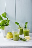 Stinging nettle and dandelion smoothies with ginger and lemon