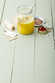 An orange and pineapple smoothie with saffron and flaxseeds