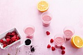Raspberry smoothies with orange, vanilla and acai powder