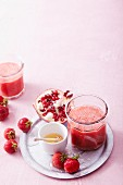 Strawberry and pomegranate smoothies with chilli and agave syrup