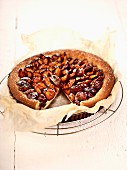Damson tart on baking paper