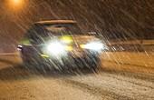 Car driving through heavy snow