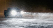 Pickup truck driving through heavy snow