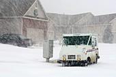 U.S. Mail truck in heavy snow