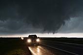 Tornado forming over road