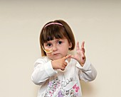 Child with nasogastric tube signing A