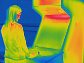 Thermogram of person playing arcade game