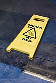 Wet floor sign in puddle