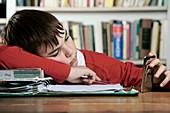 Bored boy not doing his homework