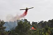 Aircraft drops fire retardant