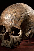 19th C. Carved dayak skull lethal wound