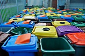 Used and damaged wheelie bins in compound